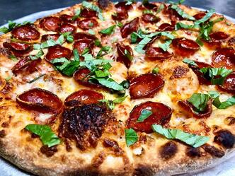 Pizza fresh out of the oven with specialty pepperoni